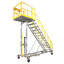 OSHA compliant, mobile aluminum work staircase stand with optional vertical telescopic guardrails lower to accommodate obstacles while maintaining 100% fall protection.