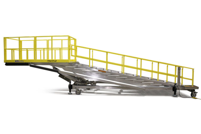 Electric powered, aluminum, height adjustable, OSHA compliant stair platform that maintains equal stair step distance at any height for reduced trip hazard.
