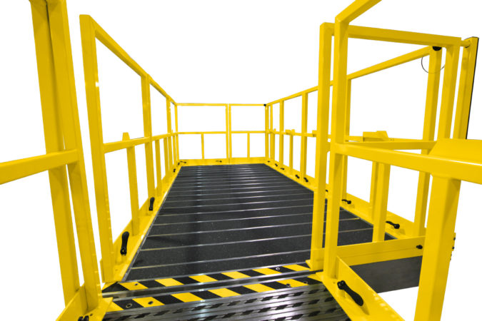 OSHA compliant, portable aluminum fleet maintenance work platforms with tool-free detachable guardrails that self-store on deck for easy reconfiguration when needed.