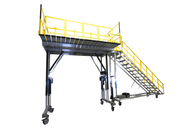 OSHA compliant mobile height adjustable work platform with custom tool-free detachable guardrails that self-store on deck for easy reconfiguration when working, and 100% fall protection when needed.