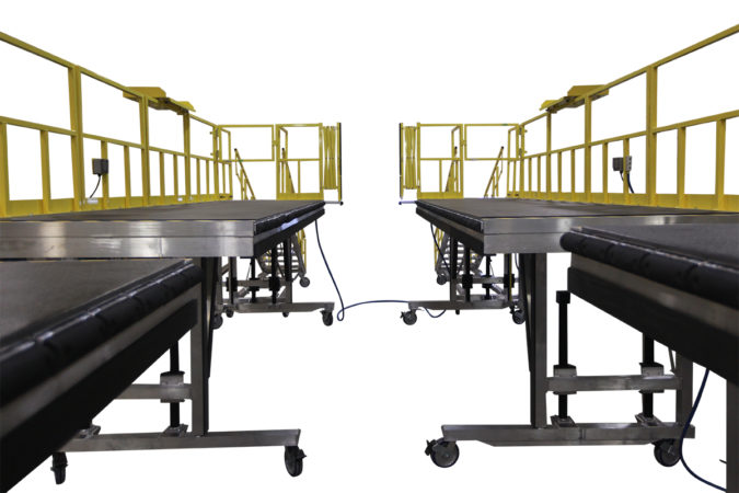 OSHA compliant portable fuselage and tail H-64 wrap-around work platforms for helicopter maintenance.