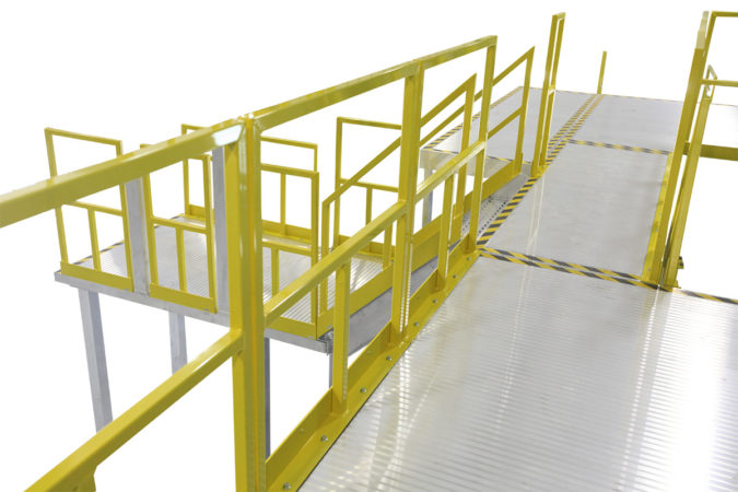 Custom, aluminum two-story work platform built to print, with bolted, powder coated handrail for OSHA compliant mezzanines, mobile scaffolding and manufacturing modules