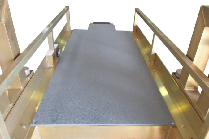OSHA compliant, custom aerospace work platform, with on deck electric controls for adjusting height, ergonomic mat provides comfort while working in recumbent position, chromate finish for ESD reduction, electric static discharge