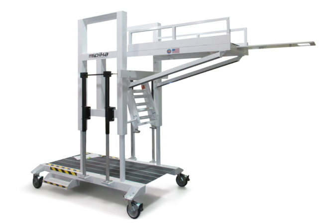OSHA compliant, mobile, custom prone access aerospace work platform, white power coat, electric actuated height adjustability to prevent falls while working safely in the recumbent position