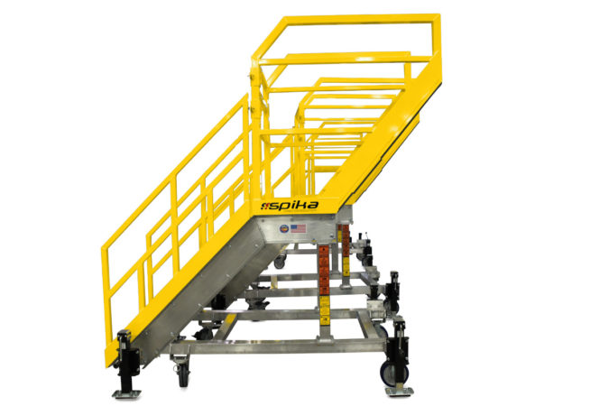 OSHA compliant, custom mobile aviation work platform, aircraft fueling stand, supports technician leaning over an obstacle, stairs with cantilevered landing
