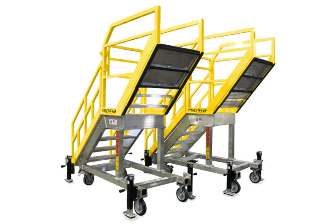 OSHA compliant, custom mobile aviation work platform, aircraft fueling stand, supports technician leaning over an obstacle, stairs with cantilevered landing, protective foam protects aircraft