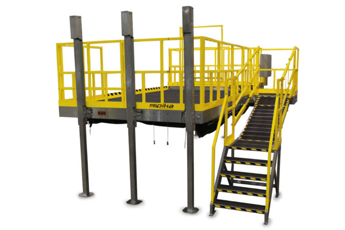 OSHA compliant electric powered aluminum work stand that raises and lowers with optional stairs or telescopic ramp that automatically adjusts with deck height.