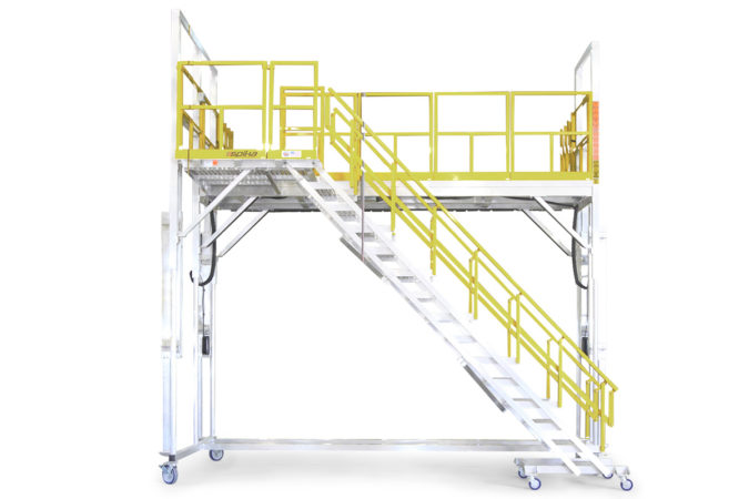 OSHA compliant electric powered, height adjustable, mobile work stand offering add on-deck accessories such as tool trays or air and electric outlets for convenience when working at extreme heights.