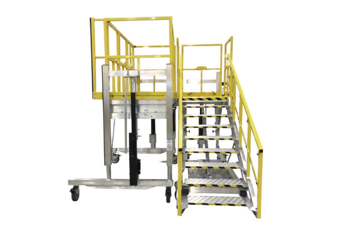 OSHA compliant, mobile, height adjustable aluminum work platform with staircase and custom adjustable guardrails offering 4-side or 3-side protection.