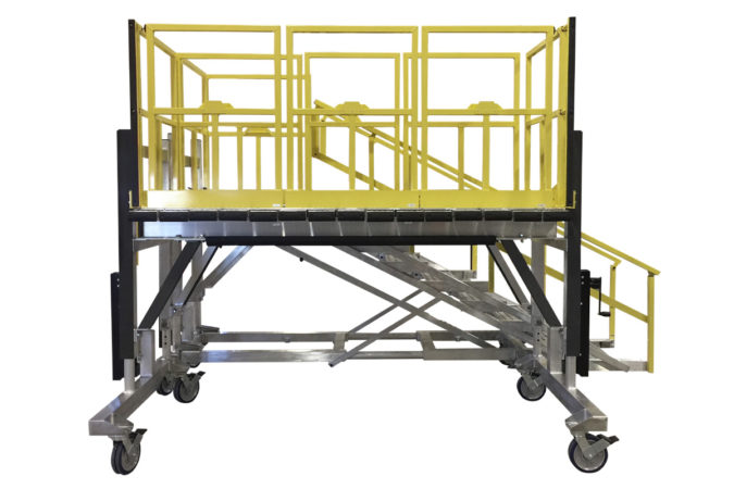 OSHA compliant, mobile aluminum work platform with adjustable handrails and detachable staircase, manual or electric height adjustability available, mechanically attached foam protects personnel and equipment.