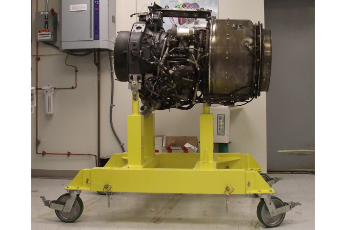 Helicopter maintenance engine service stands shown with engine.
