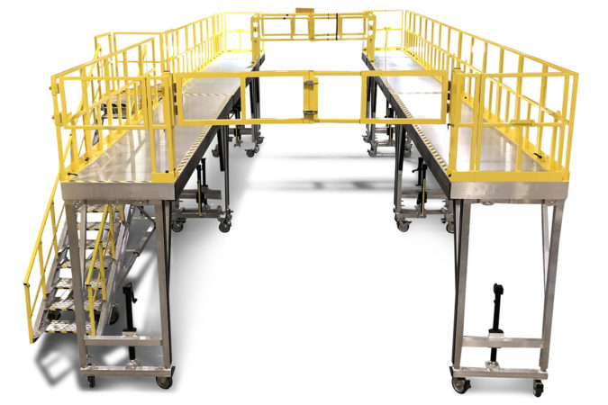 OSHA compliant mobile aluminum wrap around fleet maintenance work stands with protective foam and multiple crossover guardrails protect personnel and equipment while working.