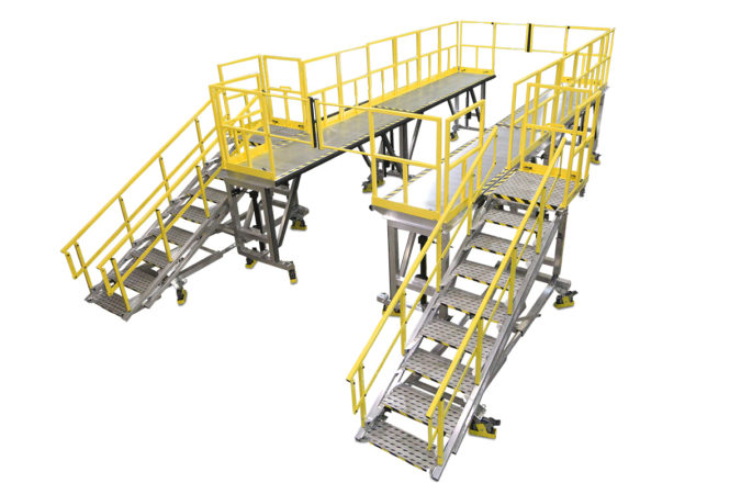 OSHA compliant, lightweight aluminum fleet wrap-around maintenance platforms comprised of four linked decks with crossover railings provided for 100% fall protection.